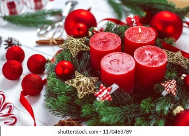 advent wreath with baubles and four red candles