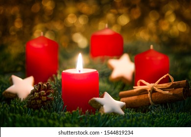 Advent wreath with burning candle on the first Sunday in advent