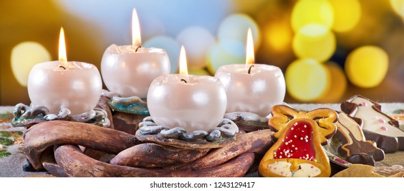 Advent Wreath with Burning Candles on the Table