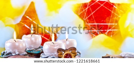 Advent Wreath with Burning Candles on the Red Background