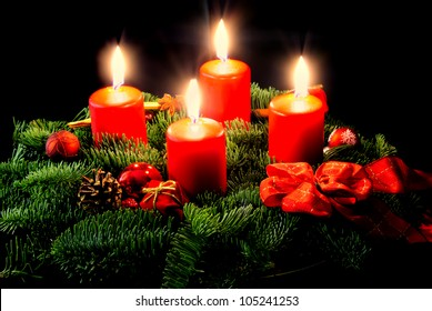 Advent wreath with candle and decorations in Christmas time