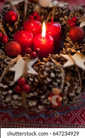 Advent wreath with candle and decorations in Christmas time.