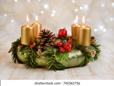 Advent wreath with four burning candles for the Christmas time