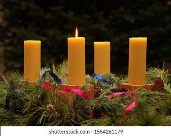 Advent wreath with four handmade  beeswax candles, with one candle lit for first Sunday of Advent; series of four photographs for Advent season
