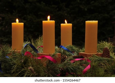 Advent wreath with four handmade beeswax candles, with three candles lit for third Sunday of Advent; series of four photographs for Advent Season
