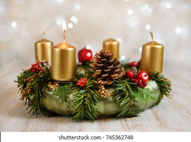 Advent wreath with one burning candle