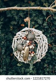 Advent wreath for the pre Christmas time. DIY Christmas decoration. Handmade decor.