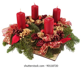 Advent wreath with red candles isolated on white.