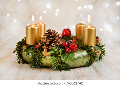 Advent wreath with three burning candles for the Christmas time