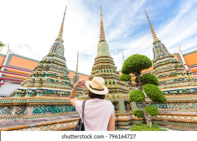 Adventure Asian beautiful tourist women travel in the buddha temple back view in Bangkok Thailand