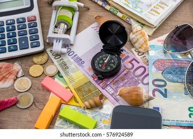 Adventure concept -  traveler items with money on desk.