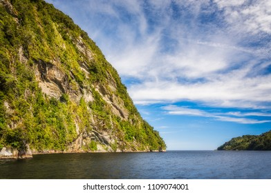 Adventure Cruise at Doubtful Sound in Fiordland National Park, New Zealand where the fjord opens to Tasman Sea. Doubtful Sound is a quieter version of Milford Sound and it is the lesser known fjord.