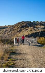 Adventure cyclist on rail trail - Shutterstock ID 1773110915