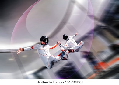 Adventure fly. Indoor sky diving. Action fly sport in wind tunnel