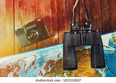 Adventure Journey Travel Scout Journey Concept. Vintage Film Camera, Map And Binoculars On Wooden Table, Flat Lay