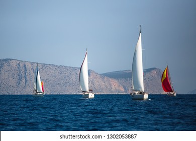 Adventure and luxury holiday. Sailing boats in the sail yacht regatta at Aegean Sea.