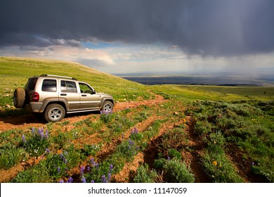adventure in the mountains, off road in an SUV, Pryor mountains with rain in the valley, Southern Montana, United States.