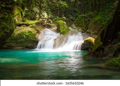 adventure river trekking in Jamaica down stream from the Reach Falls, long exposure picture