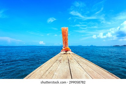 Adventure seascape background of trip journey by tourist boat in Thailand at clear summer day with blue sky. Point of view photography of ship moving