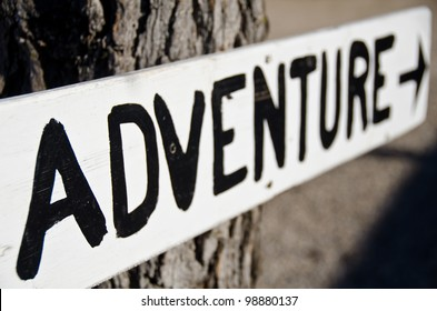 adventure sign with shallow depth of field