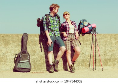 Adventure, summer, tourism active lifestyle. Young couple backpacker tramping by seaside