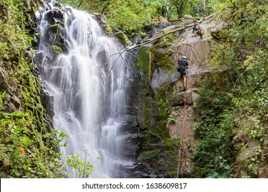Adventure tourism in tropical Costa Rica while rappelling down a beautiful waterfall  deep in the southern mountains of the country