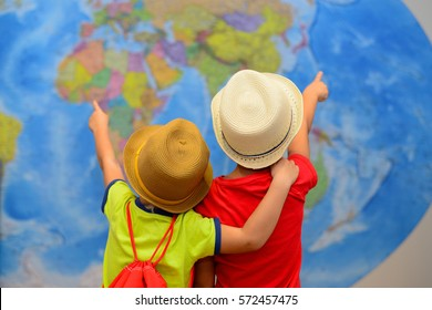 Adventure and travel concept. Happy children are dreaming about trip, vacation.