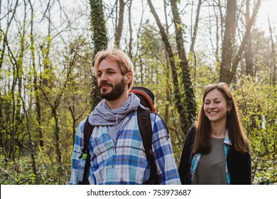 adventure, travel, tourism, hike and people concept - smiling couple with backpacks outdoors