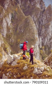 adventure, travel, tourism, hike and people concept - smiling couple walking with backpacks outdoors