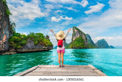 Adventure traveler woman joy fun beautiful nature scenic landscape island Phang-Nga bay, Amazed landmark travel Phuket Thailand, Tourist on summer holiday vacation trip, Tourism destination place Asia