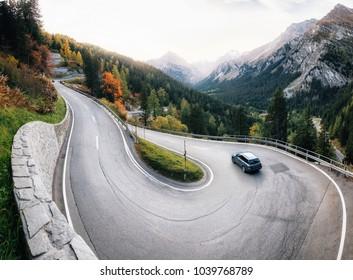 Adventure trip by car along winding mountain alpine road, Maloja Pass, Switzerland