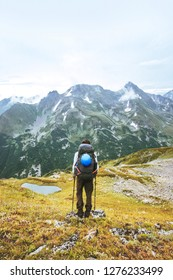 Adventurer hiking in mountains solo traveling adventure lifestyle summer vacations activity outdoor backpack gear