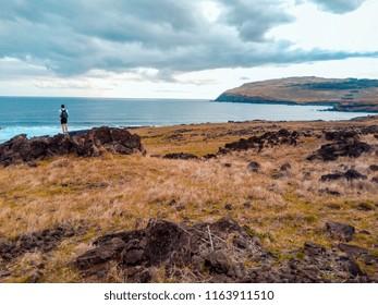 adventurer in rocks by the sea
