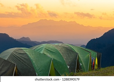 Adventures Camping tourism and tent ,view forest landscape , outdoor in morning and sunset sky at Mon Sone View point , Doi Pha Hom Pok National Park in Chiang Mai,North Thailand. Concept Travel.