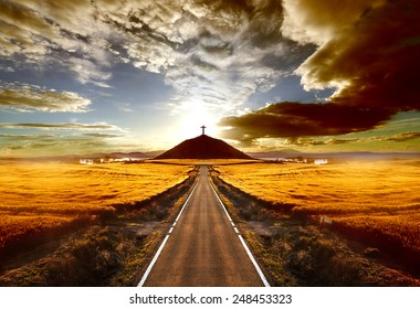 Adventures and road trips.Sunset and travel concept.Road and cross on the hill