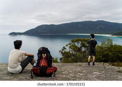 adventurous hikers look over epic Wilson's Promontory