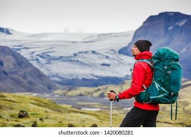 adventurous man walking on Landmannalaugar trail enjoying the view of the glacier