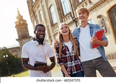 Adventurous motivated students looking happy