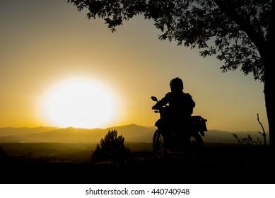 adventurous motorcycle & sunrise with motocross