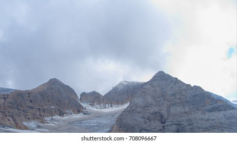 adventurous mountaineering in marmolada glacier in dolomites in italy