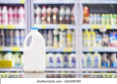 Advertise, Drink milk for healthy concept - Milk bottle in a supermarket on background blurred beverage, milk showing on shelves in the cold freezer.