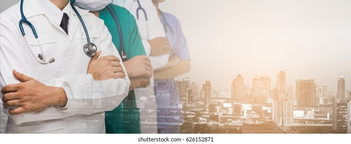 Advertise, hospital, profession and medicine concept - Cropped image of Team of doctors and nurses with stethoscopes and background blur building skyscrapers at sunset. Panorama