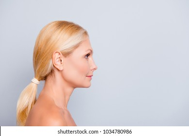 Advertisement concept. Side view, profile, half face portrait with copy space, empty place of blonde, nude, pretty, charming woman, isolated on grey background, wellness, wellbeing concept