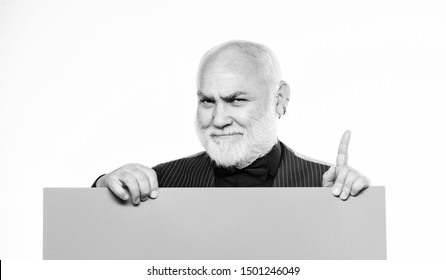 Advertisement shop. inspired mature man in formal suit. Advertisement. Senior bearded man place announcement on banner. job search. Need help. Copy space placate information. inspiration is here.