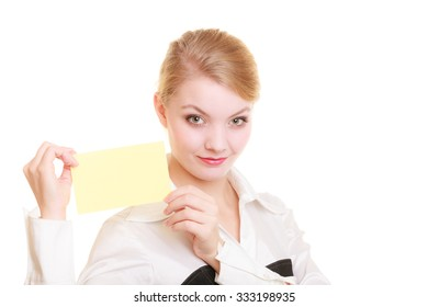Advertisement. Young woman holding blank copy space yellow business card isolated on white. Businesswoman recommending your product