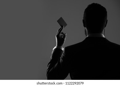 advertising of banking services. office man with paper credit card, business ethics and fashion, money and marketing, real estate, shopping, shady business