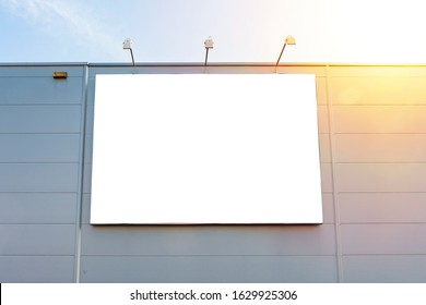 Advertising billboard mockup on the wall of warehouse/factory building