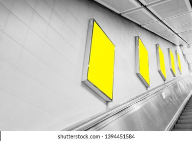 Advertising Billboard mockup vertical,yellow light box showcase indoor subway,display empty space for text design message or media content,Commercial concept business and advertise media