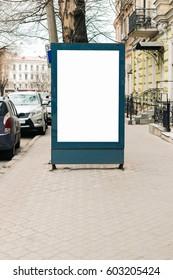 Advertising blank billboard on the sidewalk in the old city, vertical framing