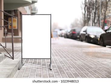 Advertising board on city street